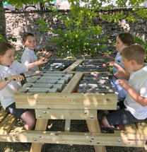 Musical Rocks - children playing musical bench
